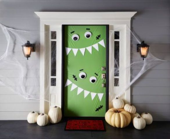 green monster door decor to invite tirck-or-treaters