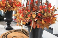 04 special Japanese lantern blossoms, blended with an abundance of varying leaves and berries, cast fall decorating in a fabulous new light