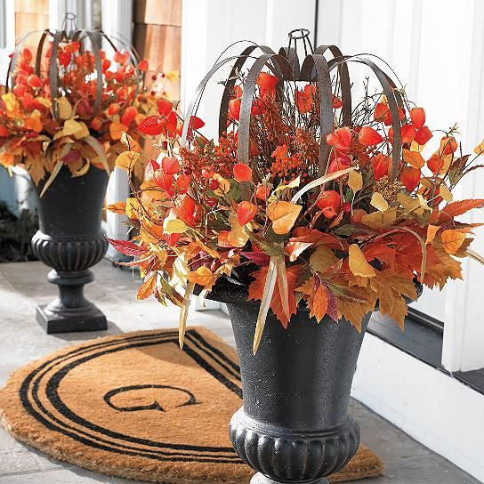 special Japanese lantern blossoms, blended with an abundance of varying leaves and berries, cast fall decorating in a fabulous new light