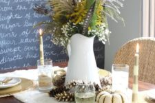 04 traditional tablescape with gilded pinecones, feathers, greenery and flowers