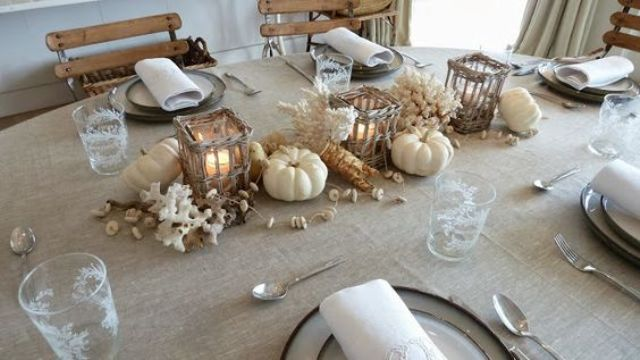 coastal tablescape with corals, white pumpkins and woven candle holders
