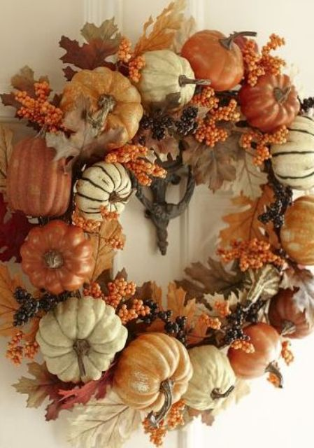 pumpkins, leaves and berries for a lush fall wreath