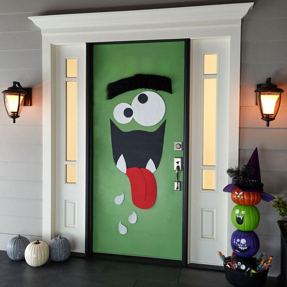 trick or treaters and other guests are sure to be delighted with such monster door decor