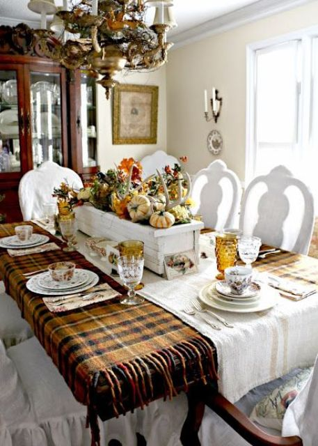 Thanksgiving table with an antler, flowers and pumpkins box centerpiece