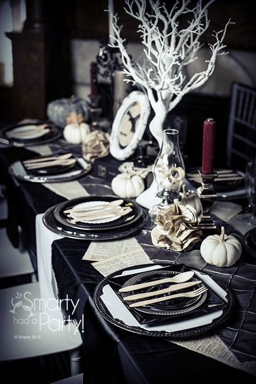 chic black and white tablescape with crimson candles