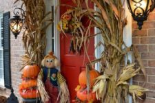 06 decorate your front porch with corn husks, stacked pumpkins and potted flowers