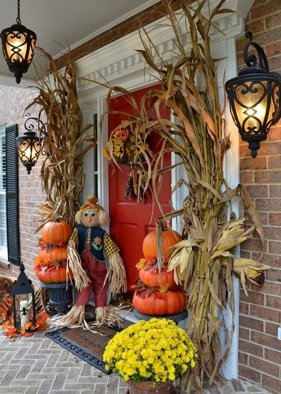 decorate your front porch with corn husks, stacked pumpkins and potted flowers