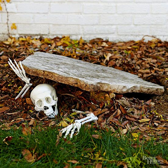 pieces of a plastic skeleton make a creepy entrance in this simple outdoor Halloween décor idea