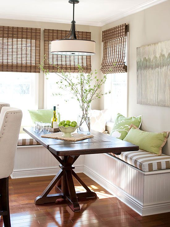 rustic shades add to the decor of this breakfast nook