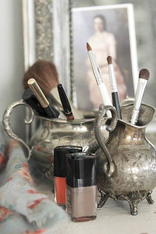 vintage silver items as brush holders
