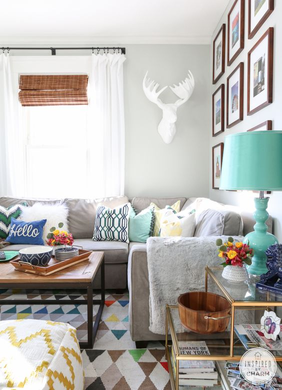 white deer head works perfectly in this eclectic space