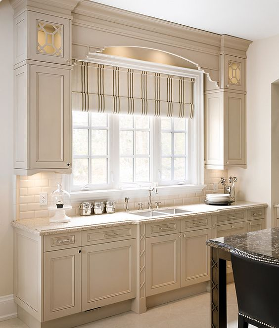 elegant striped shades make this kitchen more classic