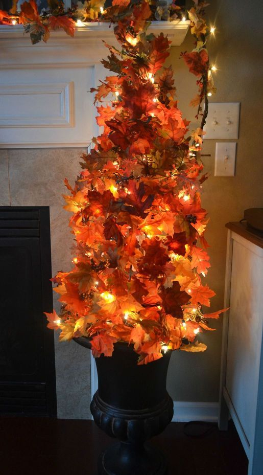 make your own fall topiary tree using a tomato cage, fall leaves and lights