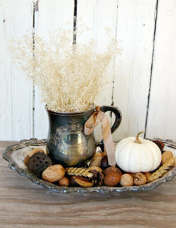 silver tray with a fall arrangement