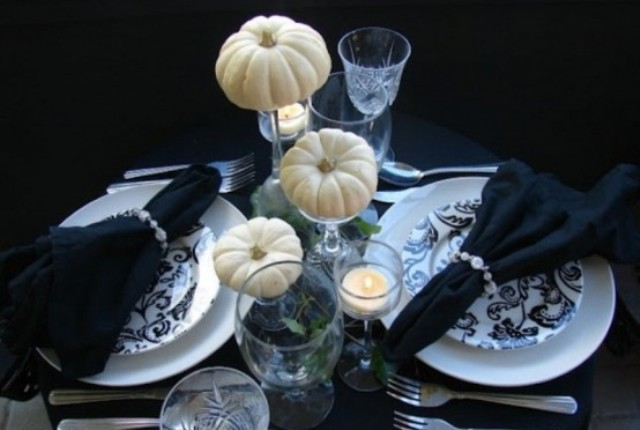 simple black and white table with greenery and faux pumpkins