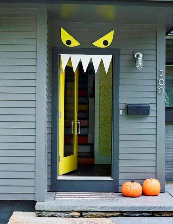 simple monster door decor with eyes and teeth can be made in a couple of minutes