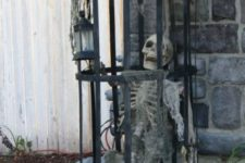 07 skeleton in a cage will be a great decoration in your outdoor spaces