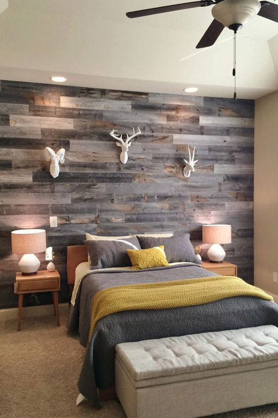 weathered wood wall looks amazing with small white faux heads
