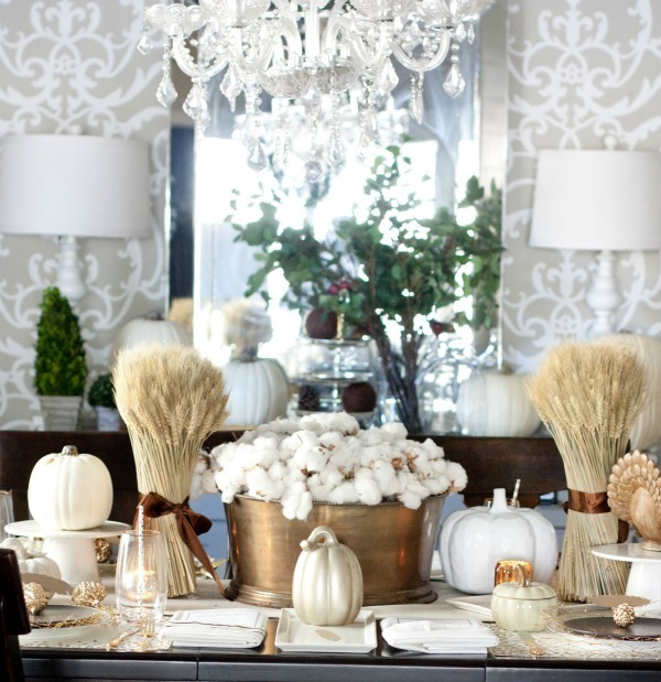 cozy holiday table with white pumpkins, a cotton centerpiece and wheat