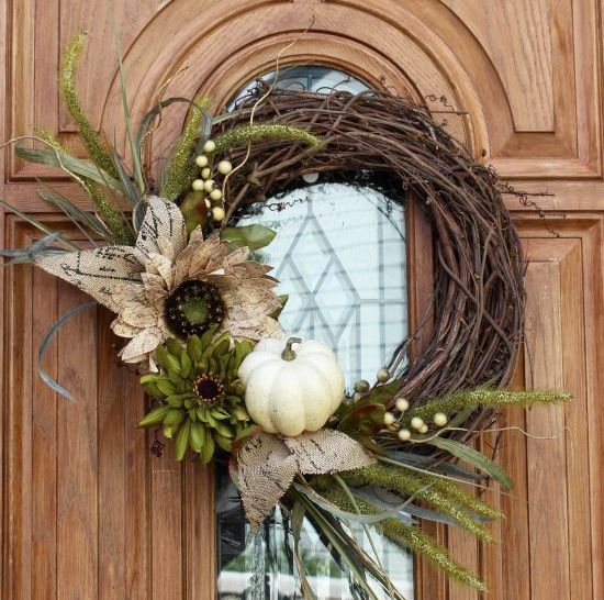 faux leaves and a pumpkin on this simple wreath look gorgeous