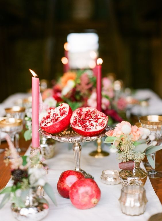make easy centerpieces just cutting pomegranates in halves and placing them on stands