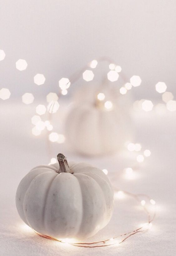 mix white pumpkins with lights for elegant and lively fall decor