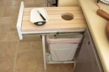 08 pull-out cutting board will save space and scraps will be in trash at once