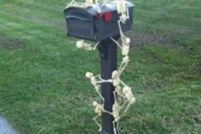 08 small skeletons clmbing up the mailbox is a fun idea