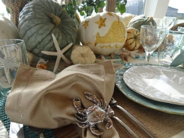 Thanksgiving table with a crab napkin ring and cool nautical pumpkins