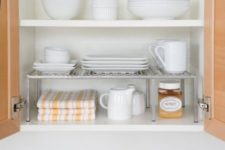 09 extra cabinet shelves for storing small dishes and mugs