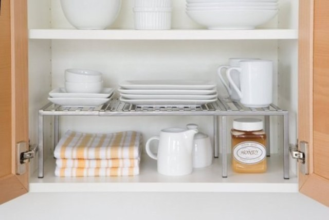 extra cabinet shelves for storing small dishes and mugs