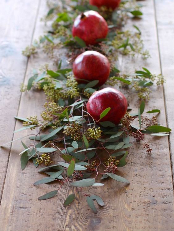 festive table runner with pomegranates and greenery