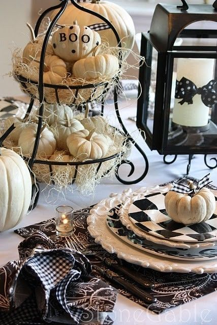 monochrome Halloween tablescape with elegant checked dishes