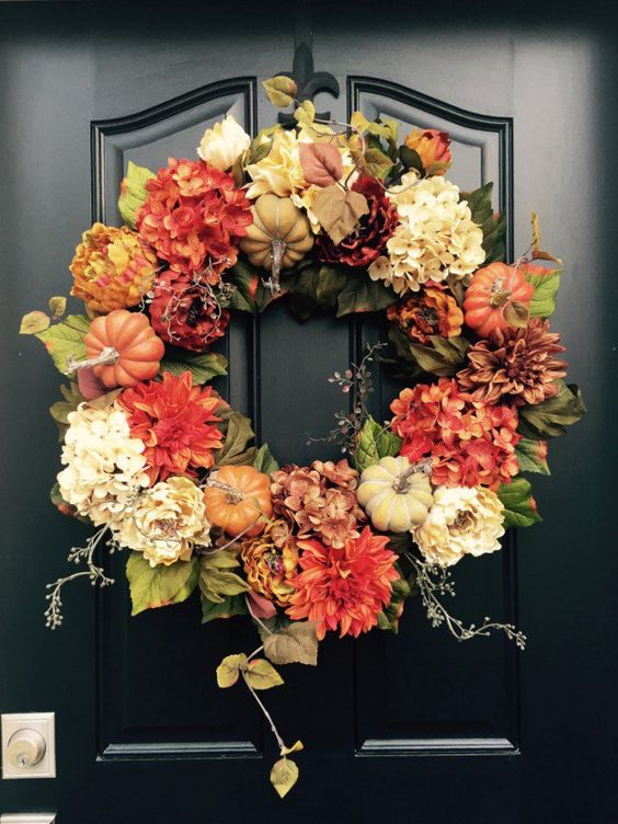 silk flowers and faux pumpkins are an ideal combo for every fall wreath