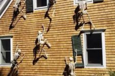 09 skeletons climbing up the side of the house