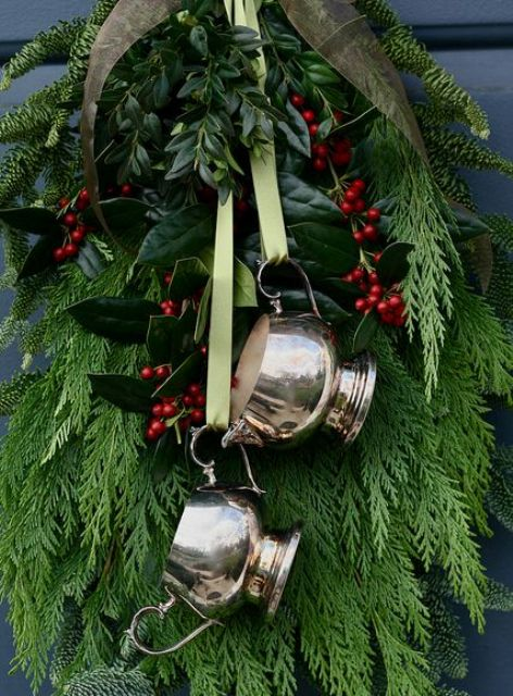 Christmas door swag with vintage silver pieces and fir branches