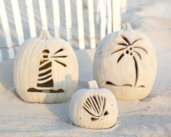 beach pumpkins carved with coastal motif and covered with sand