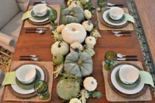 10 green and white table with a pumpkin table runner and woven placemats