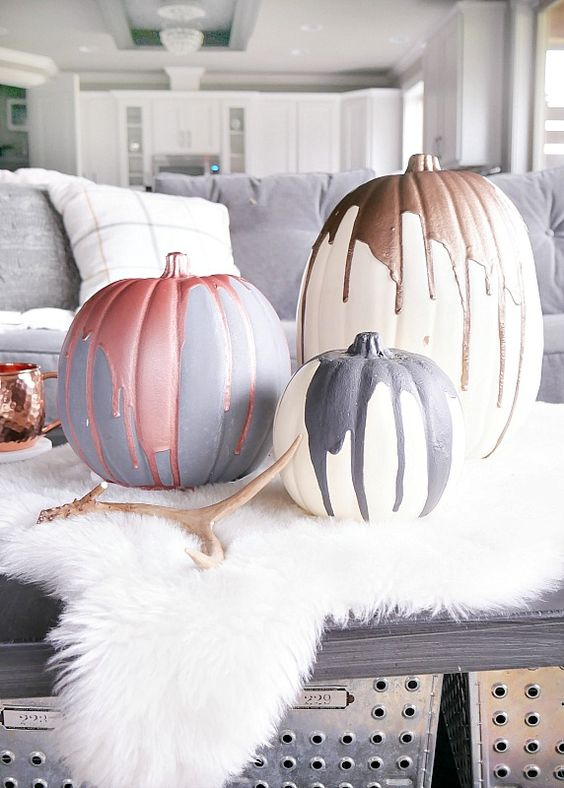modern meallic pumpkins reminding of blood dripping