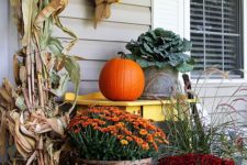 10 potted flowers, corn husks, a faux wreath and faux gourds