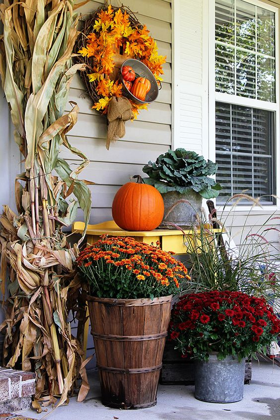 potted flowers, corn husks, a faux wreath and faux gourds