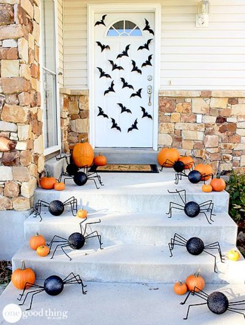 pumpkins and DIY spiders for stairs and bats attached to the door