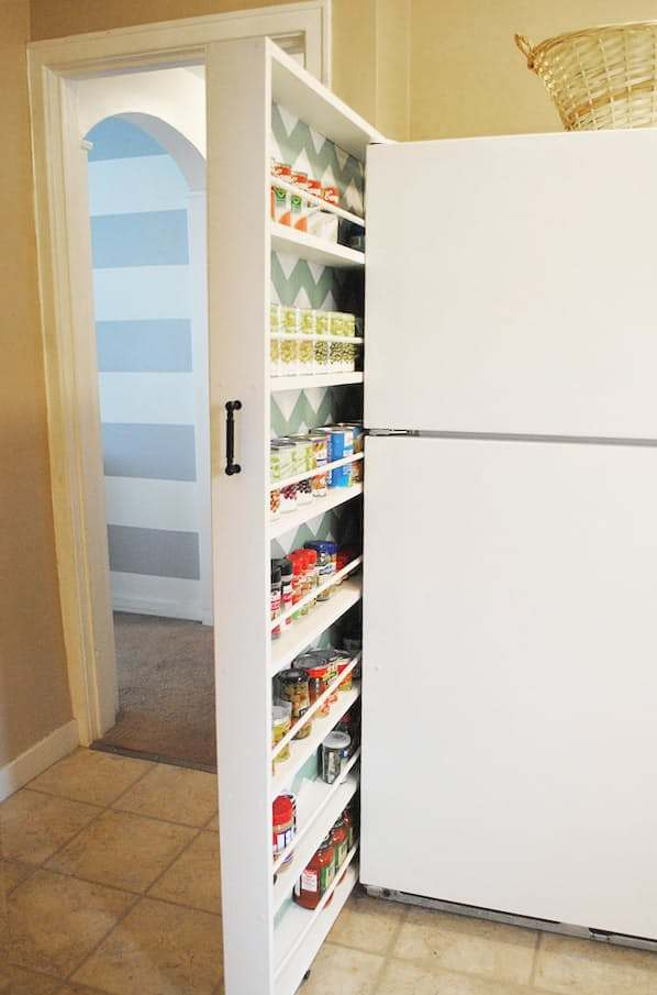 roll-out pantry cabinet makes excellent usage of few inches next to the fridge