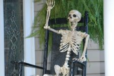 10 skeleton sitting in a chair is a great creepy decoration