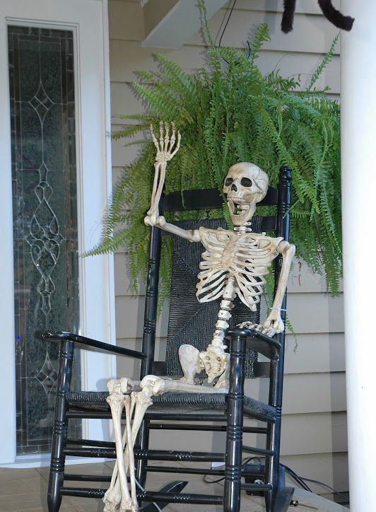 skeleton sitting in a chair is a great creepy decoration