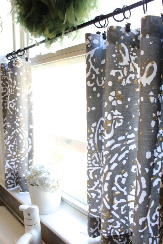 Fancy cafe curtains give privacy and a great look to your kitchen