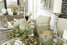 11 farmhouse-inspired table with silver candle holders, greenery and fresh pumpkins