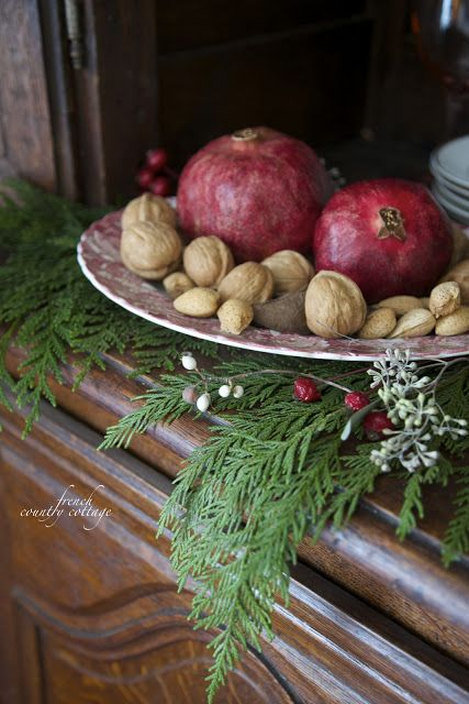 nuts and pomegranates on a dish for home decor