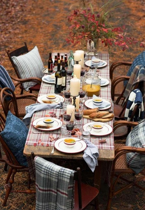 plaid table runner and blankets for celebrating fall outdoors
