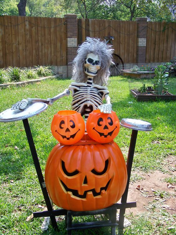 skeleton musician with pumpkin instruments